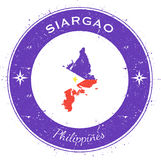Siargao circular patriotic badge. Grunge rubber stamp with island flag, map and name written along circle border, vector illustration Royalty Free Stock Images