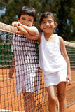 Sibblings at a tennis court Stock Image