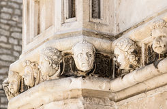 Sibenik, The Cathedral, Croatia. Sibenik Cathedral, Croatia.Famous sculpture human heads on the side portal of The Cathedral of St. James, Sibenik,Croatia.The Royalty Free Stock Image