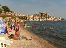 Sibenik, Croatia - August 18, 2017: Tourists relaxing on the beach near old city Sibenik, Croatia. stock images