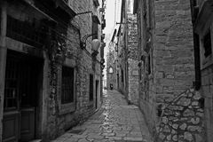Sibenik, Croatia. Tourist city by the Adratic sea - Sibenik, Croatia. The old stones, narrow street and stairs royalty free stock photography