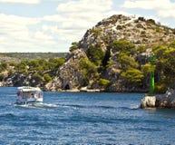 Sibenik, Croatia - touristic boat at the entrance of the sea cha Stock Image
