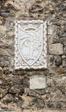 Sibenik, Escutcheon. Coat of Arms on a stone wall in the Croatian city of Sibenik Royalty Free Stock Photos