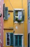 Sibenik. Too Many Windows. Windows in a courtyard of the Croatian town of Sibenik Stock Photo