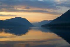Siberia. Mirror of Teletskoye lake in the morning. Siberia. Mirror of Teletskoye lake early in the morning royalty free stock images