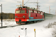 Siberia. The red locomotive and passenger train Stock Images