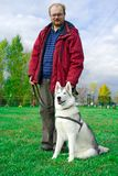 Siberian Husky with a man Royalty Free Stock Photography