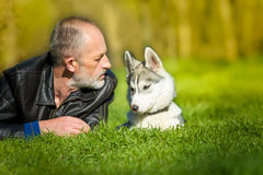 Siberian Husky and she owner Royalty Free Stock Photography