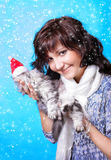 Young woman with kitten in snow Stock Photography