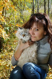 Siberian nevsky masqarade cat and young woman. In a  autumn nature Stock Image