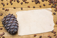 Siberian pine nuts and vintage paper sheet on wooden table Stock Photo