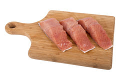 Siberian salmon on wooden board. Cut slices of fish Siberian salmon on kitchen board isolated on white background Royalty Free Stock Photo