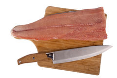 Siberian salmon on wooden board. Filet of fish Siberian salmon on kitchen board and knife isolated on white background Stock Photos