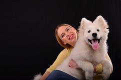 Siberian samoyed och ung flicka Royaltyfria Foton