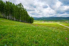 Siberian village. In the foothills of the Sayan Mountains, Khakassia, Russia royalty free stock photos