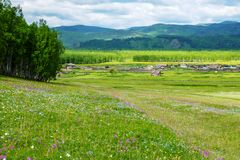 Siberian village. In the foothills of the Sayan Mountains, Khakassia, Russia stock photos