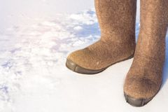 Siberian warm shoes boots. Russian footwear for frost. Copy space on white background royalty free stock photo