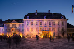 Sibiu City Center. Brukenthal Museum in Sibiu, a famous baroque building from XVIIIth century in Transylvania Romania, by night in winter with Christmas Royalty Free Stock Image