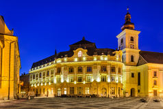 Sibiu, City Hall and Large Square in night, Romania Stock Photos