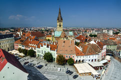 Sibiu downtown in Transylvania, Romania. View of Small Square and Evangelic Church of Sibiu, taken from Council tower, saxon scenery from Transylvania in Romania Stock Photos
