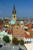 Sibiu downtown in Transylvania, Romania. View of Small Square and Evangelic Church of Sibiu, taken from Council tower, saxon scenery from Transylvania in Romania Royalty Free Stock Image