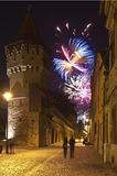 Sibiu fireworks. Medieval tower in Sibiu and fireworks in background Royalty Free Stock Images
