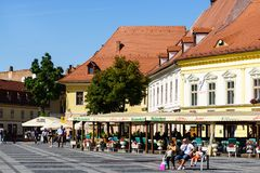 Sibiu, Romania - July 3, 2018: Central square in historical city Sibiu, Romania. People enjoying a quiet afternoon in Sibiu`s Main Square. Piata Mare, Sibiu stock photos