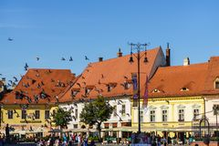 Sibiu, Romania - July 3, 2018: Central square in historical city Sibiu, Romania. People enjoying a quiet afternoon in Sibiu`s Main Square. Piata Mare, Sibiu royalty free stock image