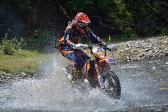 SIBIU, ROMANIA - JULY 18: A copetitor in Red Bull ROMANIACS Hard Enduro Rally with a KTM motorcycle. The hardest enduro rally in the world. July 18, 2015 in royalty free stock photography