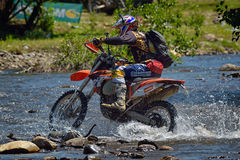 SIBIU, ROMANIA - JULY 18: A copetitor in Red Bull ROMANIACS Hard Enduro Rally with a KTM motorcycle. The hardest enduro rally in the world. July 18, 2015 in stock photography
