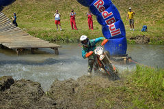 SIBIU, ROMANIA - JULY 18: A copetitor in Red Bull ROMANIACS Hard Enduro Rally with a KTM motorcycle. The hardest enduro rally in the world. July 18, 2015 in stock image