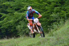 SIBIU, ROMANIA - JULY 16: Jonathan Walker competing in Red Bull ROMANIACS Hard Enduro Rally with a KTM 300 EXC Factory motorcycle. Royalty Free Stock Photos