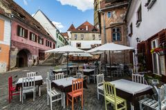Sibiu - Romania, July 18, 2017: People on the center of the city. Cafe in the center of the city Sibiu, Transylvania Royalty Free Stock Image