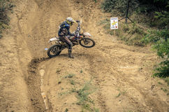 SIBIU, ROMANIA, JULY 16, 2016: Rider next to chicken line at Red Bull ROMANIACS Hard Enduro Rally Royalty Free Stock Image