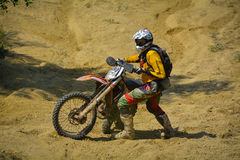 SIBIU, ROMANIA - JULY 18, 2015: Tobias Schrot competing in Red Bull ROMANIACS Hard Enduro Rally with a KTM GST Berlin motorcycle. Royalty Free Stock Photos