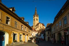 Sibiu - Romania, July 18, 2017: Transylvania. Lutheran Church, built in the Huet Square, seen from the streets of medieval Lower T. Own city Stock Images