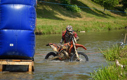 SIBIU, ROMANIA - JULY 16: Unknown competing in Red Bull ROMANIACS Hard Enduro Rally with a KTM 300  motorcycle. The hardest enduro rally in the world Stock Images