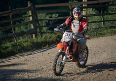 SIBIU, ROMANIA - JULY 16: Unknown competing in Red Bull ROMANIACS Hard Enduro Rally with a KTM 300  motorcycle. Royalty Free Stock Photos