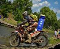 SIBIU, ROMANIA - JULY 16: Unknown competing in Red Bull ROMANIACS Hard Enduro Rally with a KTM 300  motorcycle. Royalty Free Stock Images