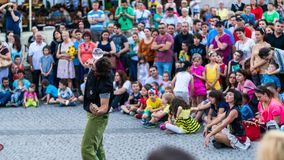 SIBIU, ROMANIA - 17 JUNE 2016: A member of Kinemtatos, Manoamano Circo, Argentina performing a trick in the Little Square during S royalty free stock images