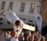 Acrobat balancing on man's head Royalty Free Stock Photos