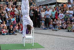 Juggler guy sitting in the head. Sibiu, Romania - June 2, 2012: Sibiu International Theatre Festival, the biggest performing arts festival in Romania and the Royalty Free Stock Photo