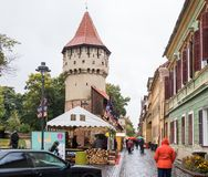 The famous Tower of the Carpenters - Turnul Dulgherilor - on the Cetatii street in a rainy day. Sibiu city in Romania. Sibiu, Romania, October 07, 2017 : The Royalty Free Stock Photo