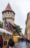 The famous Tower of the Carpenters - Turnul Dulgherilor - on the Cetatii street in a rainy day. Sibiu city in Romania. Sibiu, Romania, October 07, 2017 : The Stock Photography