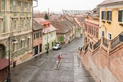 Fragment of Ocnei street neat to the Small Square in a rainy day. Sibiu city in Romania Royalty Free Stock Images