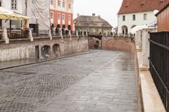 Fragment of Small Square in a rainy day in Sibiu city in Romania. Sibiu, Romania, October 07, 2017 : Fragment of Small Square in a rainy day in Sibiu city in Stock Image
