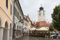 Fragment of Small Square in a rainy day in Sibiu city in Romania. Sibiu, Romania, October 07, 2017 : Fragment of Small Square in a rainy day in Sibiu city in Royalty Free Stock Photography