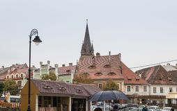 Fragment of Small Square in a rainy day in Sibiu city in Romania. Sibiu, Romania, October 07, 2017 : Fragment of Small Square in a rainy day in Sibiu city in Stock Images