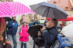 The guide tells the group about the place in which they are in Sibiu city in Romania. Sibiu, Romania, October 07, 2017 : The guide tells the group about the Royalty Free Stock Photography