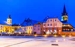 Sibiu, Romania. Sibiu, Transylvania. Evangelical Cathedral dominates Small Square with Huet Square, medieval Saxon city of Sibiu, Romania Stock Photography